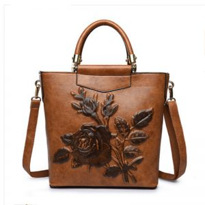 custom brown embossed floral leather handbag