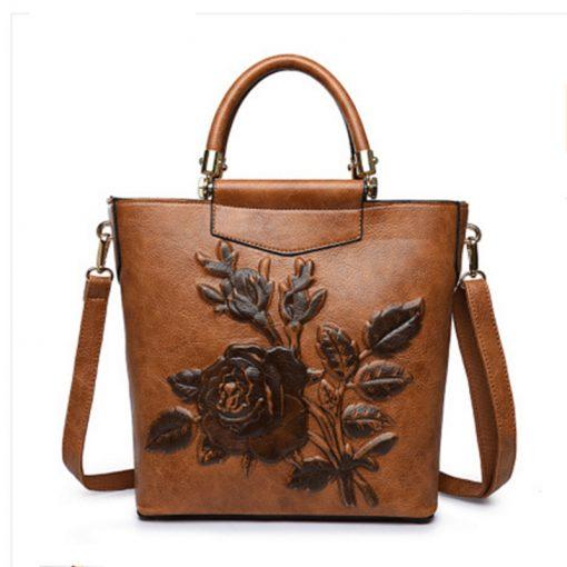 custom brown embossed floral leather handbag