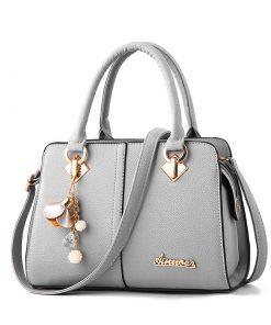 custom grey leather handbag with metal logo