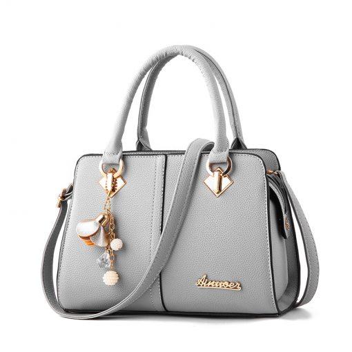 custom grey leather handbag with metal logo